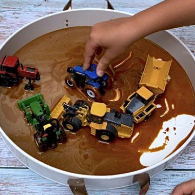 *Taste-Safe Mud Tractors Sensory Bin
