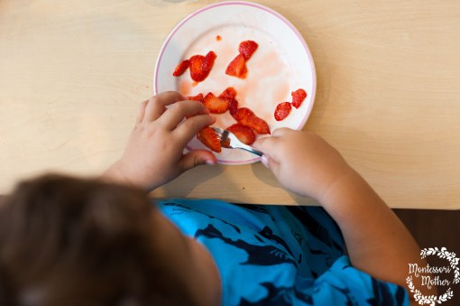 toddler eats at Montessori table