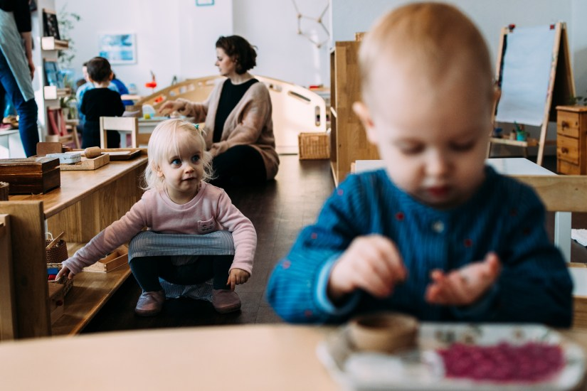 toddlers doing practical life work in montessori class