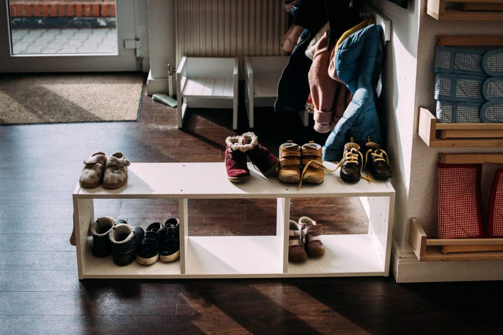 montessori dressing area, frames, ikea hack, shoe shelf, shoe brushing, spice rack, book display, frame display, toddler shoes, cube chair, selfcare, nienhuis, berlin montessori school