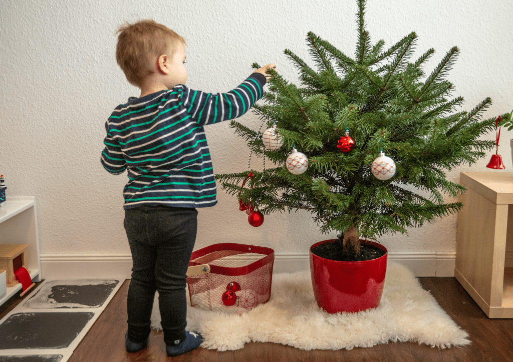 culture practical life activity decorating a holiday christmas tree with toddlers