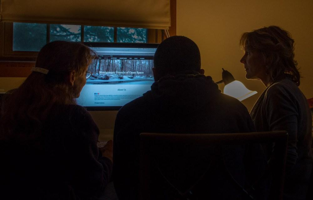 Martha Elliott, Khürt Williams, and Leslie Brecknell working on the web site.