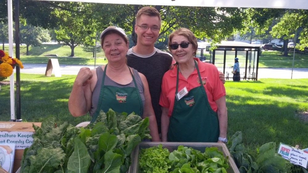 Lorette Pruden and Maxine Baicker with Dan Penny on his last official day working for the Farmers\' Market.  VS985 4G f/2.4  ISO-50 3.97mm