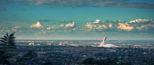 View of Montreal on a clear day. Note the Olympic Stadium to the right. Photo credit: Antoine Mghayar/Wikimedia Commons.