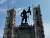 Monument to Paul de Chomedy, sieur de Maisonneuve, one of the two founders of Ville-Marie (Montreal). Notre-Dame Basilica is in the background. Photo credit: Achim-ft/Wikimedia Commons.