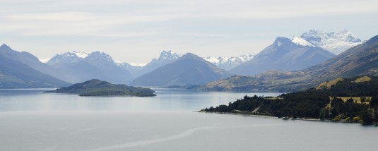 Lake Wakatipu just outside of Queenstown, New Zealand, with snowcapped mountains just beyond the far shore
