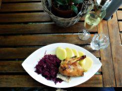 Roast duck, potato dumplings and red cabbage