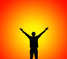 Man lifting hands to sunset