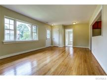 Gleaming hardwood floors and abundant natural light in your new