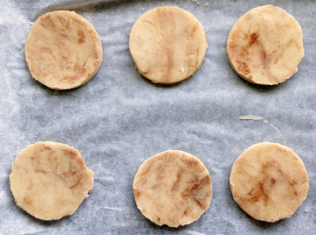 Raw sugar cookie dough on parchment.
