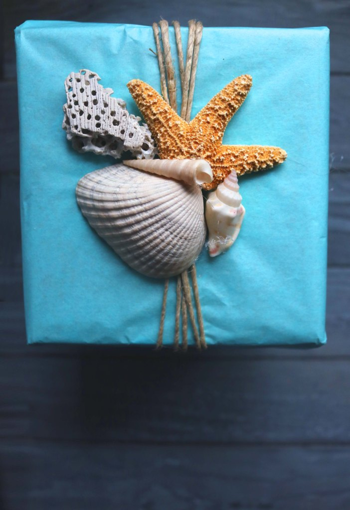 Use seashells instead of a bow for wrapping your gifts this year, plus other ideas for upcycled and natural wrappiong.