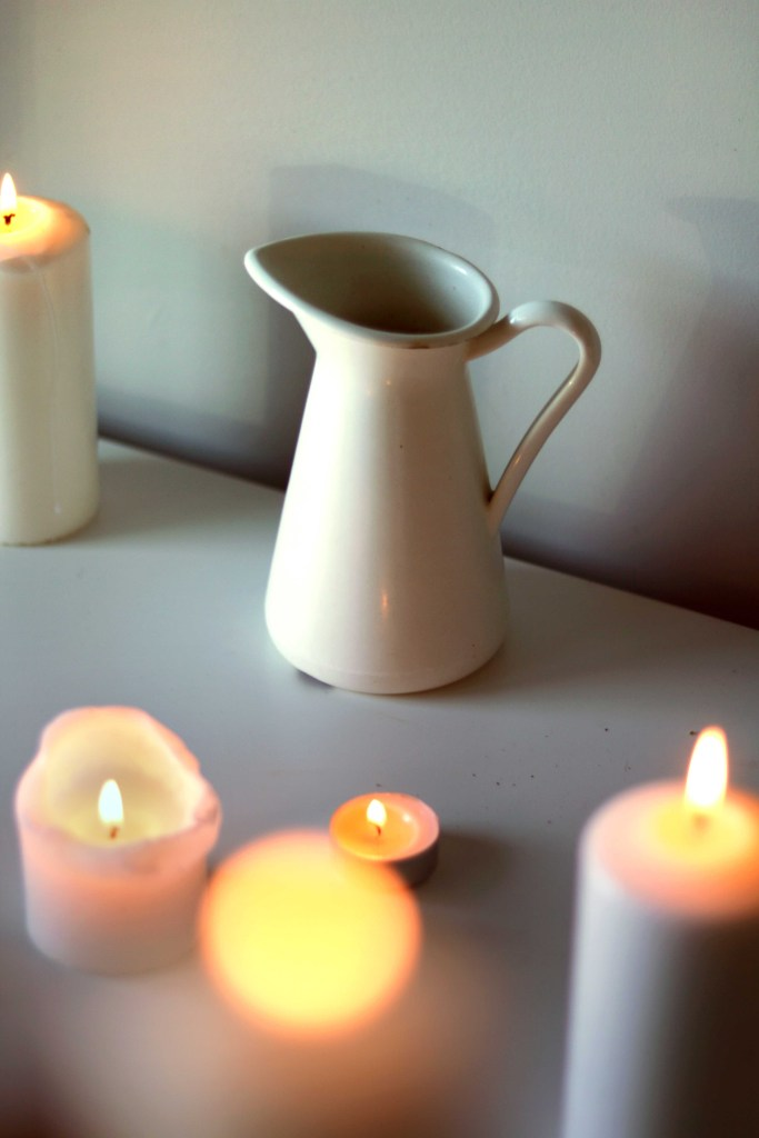 A french cream pitcher symbolizes milk on this Imbolc altar.