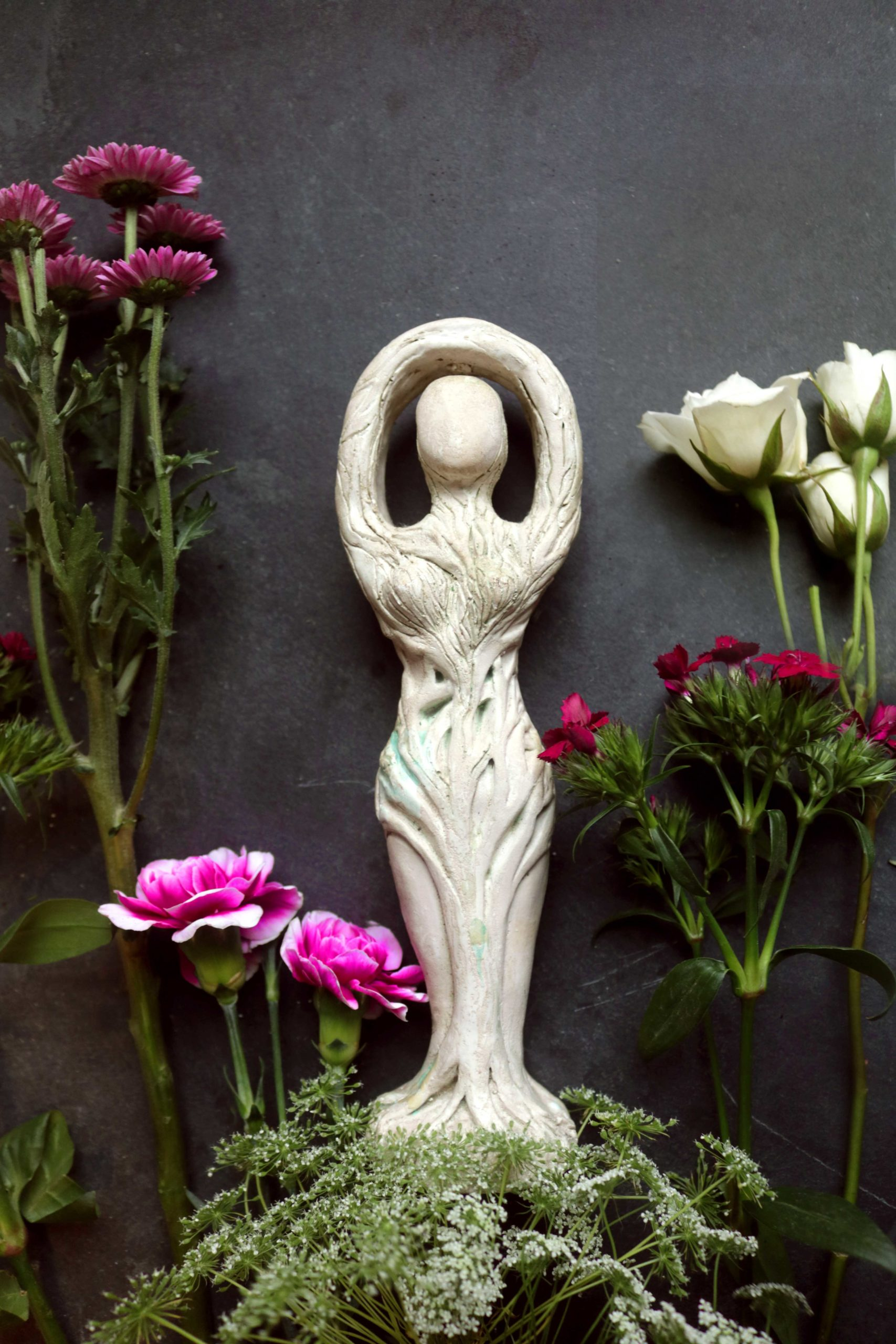 Anoint garden statues with spell oil, and other clever gardening ideas from a green witch.