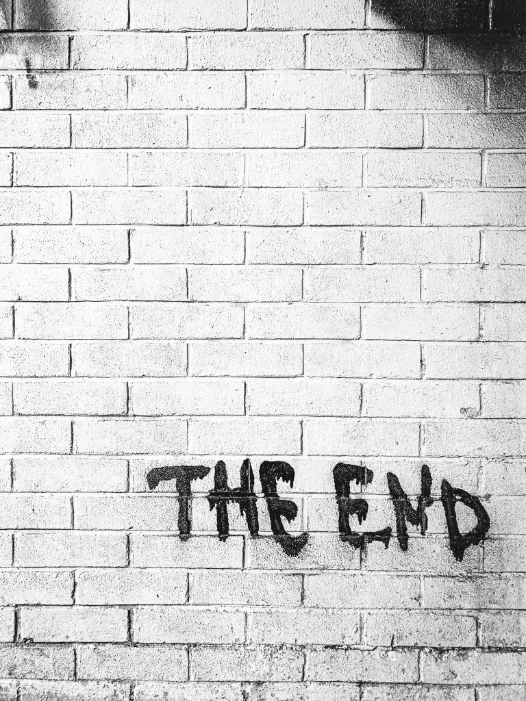 "brick wall with the words ""the end"""