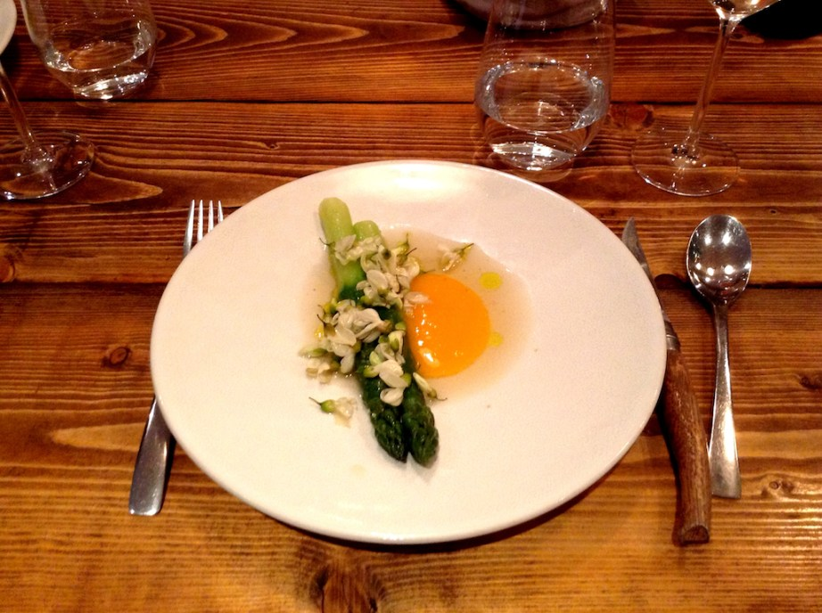 Asparagus, egg yolk confit, chicken broth, acacia flower
