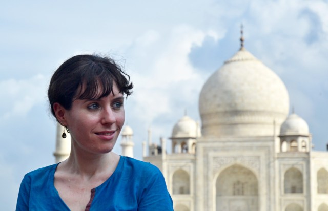 Moon author Margot Bigg stands in the foreground with the stunning form of the Taj Mahal behind her.