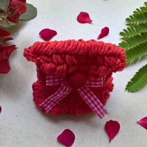 Red bobble purse.
