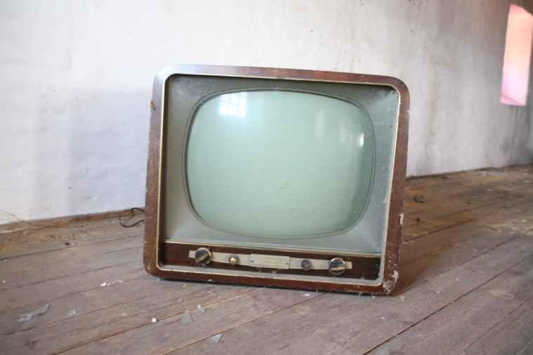 vintage brown crt tv on parquet wood flooring