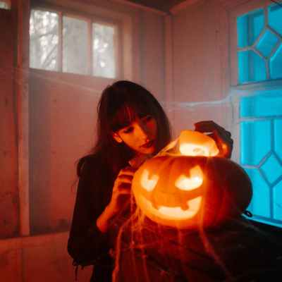 woman with a carved pumpkin