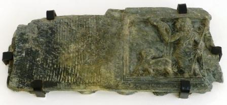 Basalt stela depicting Dionysus, carrying a horn of plenty and athysus, accompanied by a panther.r