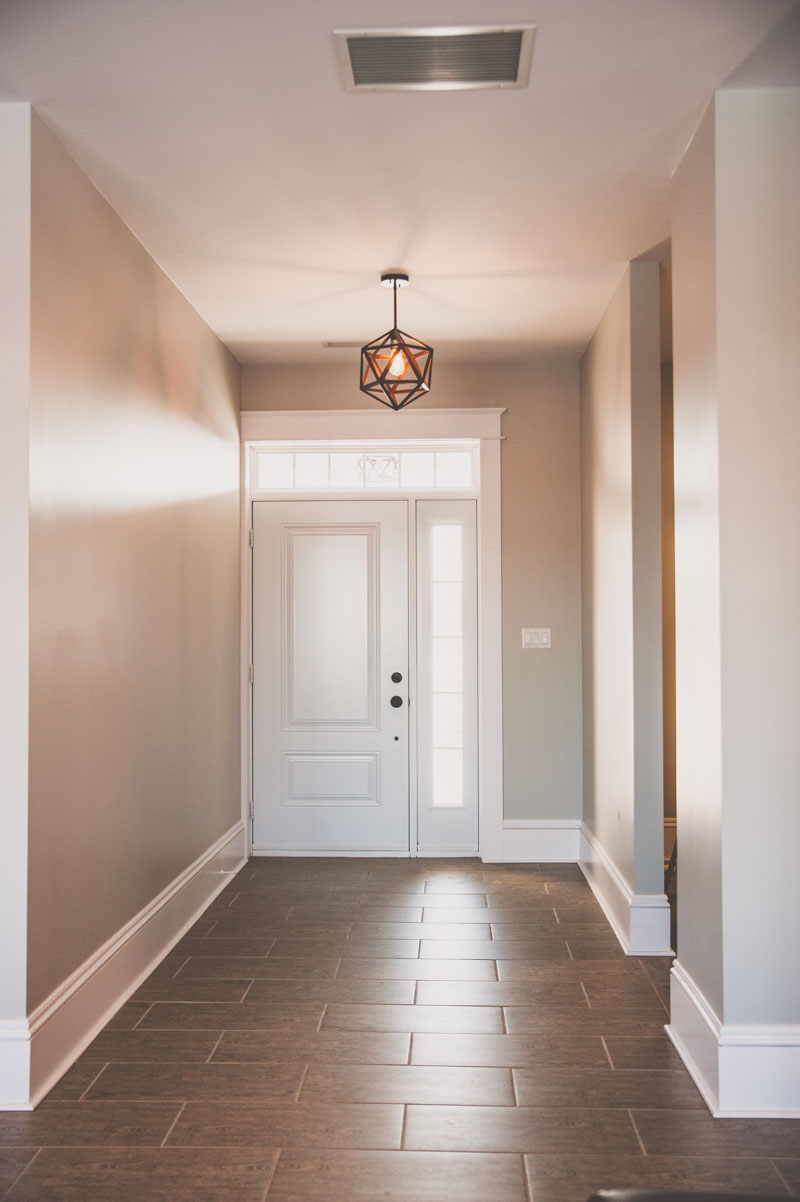 Front entrance showcases the wide baseboard tirm used throughout the home.