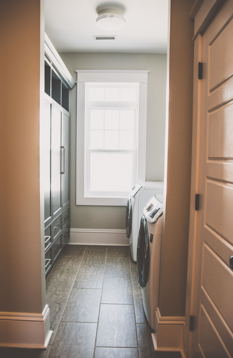 A large laundry room with ample built in storage