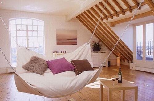 fotografia decoracion atico cama colgando