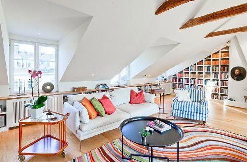 fotografia atico decorado con paredes y mobiliario blanco detalles coloridos