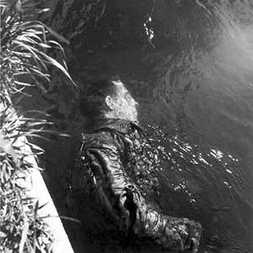 dead ss guard floating in canal lee miller