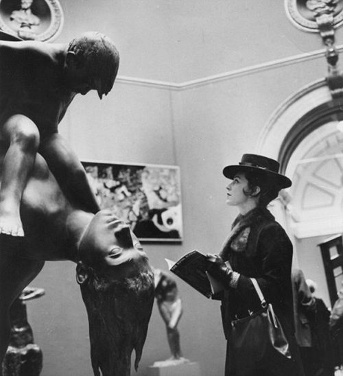 Mrs Valerie Davis standing in front of  a sculpture at the Royal Academy's Summer Exhibition in London.    (Photo by Evening Standard/Getty Images)