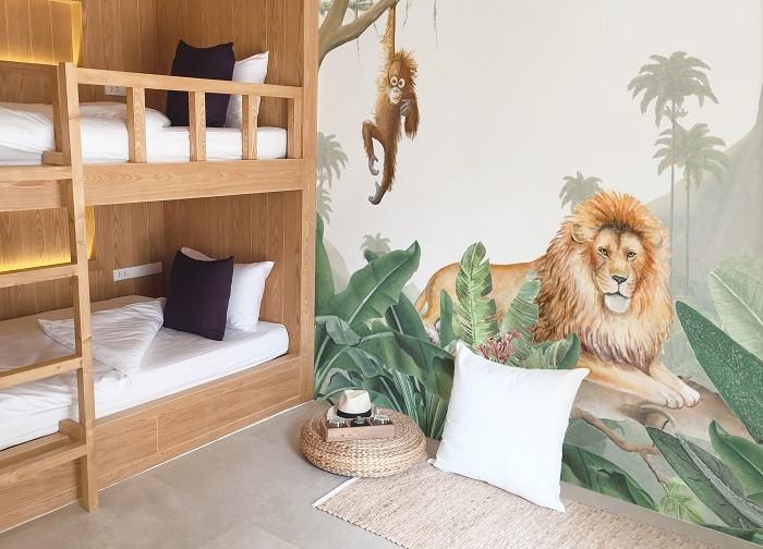 Dormitorio infantil con pintura mural