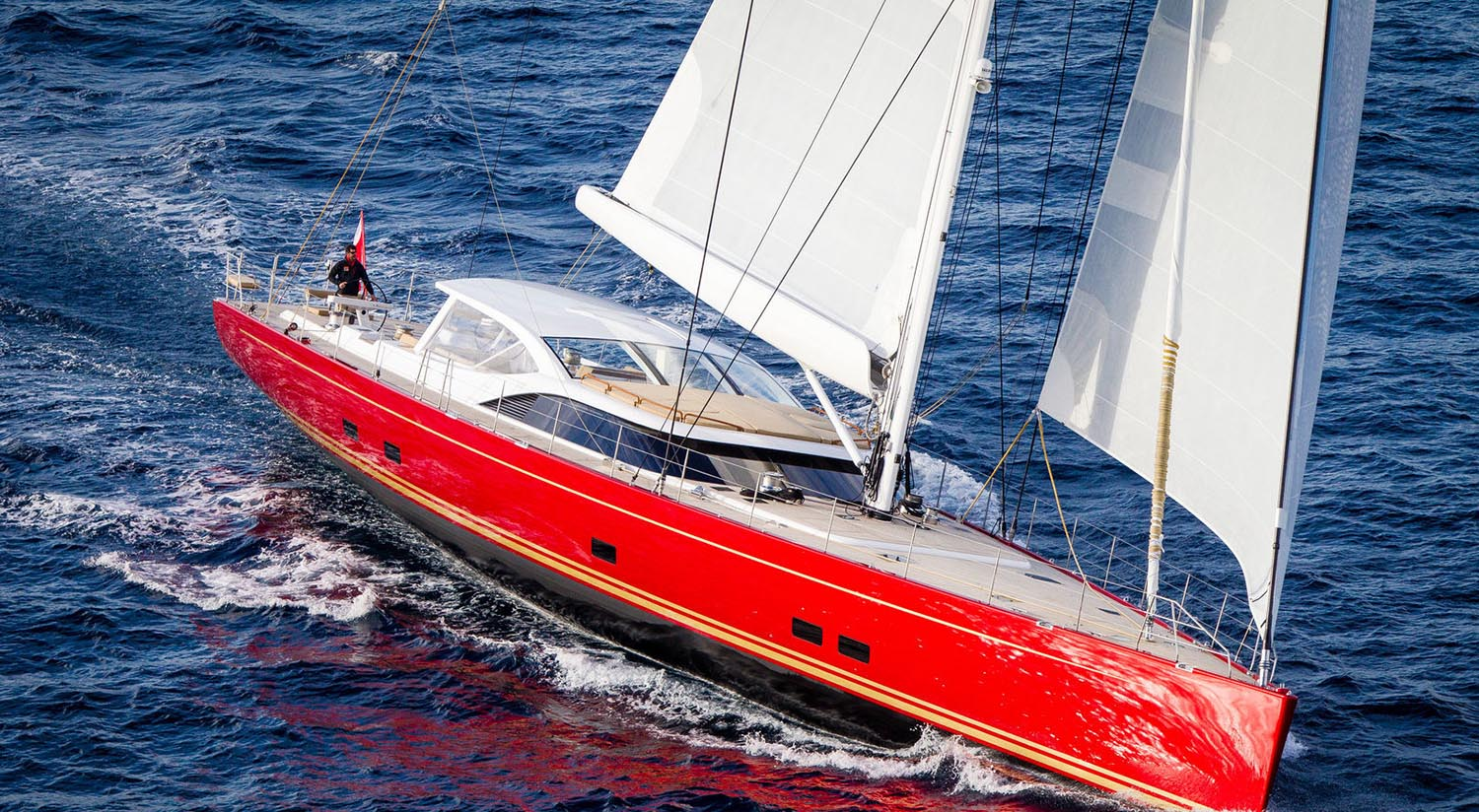 red wrapped sailing yacht