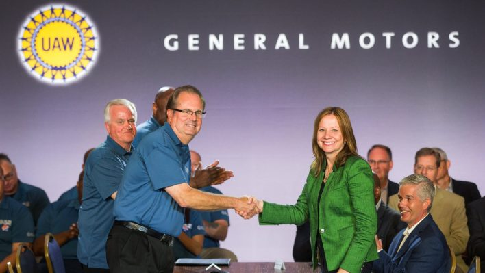 Former United Auto Workers President Gary Jones (left), and General Motors Chairman and CEO Mary Barra shake hands to open contract negotiations Tuesday, July 16, 2019. (GM).
