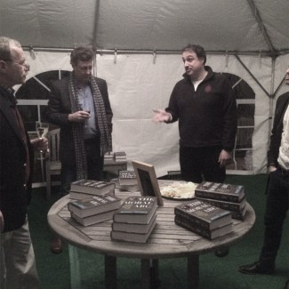 Host Gerry Ohrstrom (left) chats with Houdini biographer William Kalush (right).