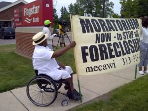 Jerome Jackson supporting Fannie Mae Fighter Jennifer Britt at a demonstration against Flagstar Bank on June 16, 2012.  Flagstar Bank was the servicer of Jennifer Britt's mortgage.  Fannie Mae owns Jerome's and Jennifer's mortgages.