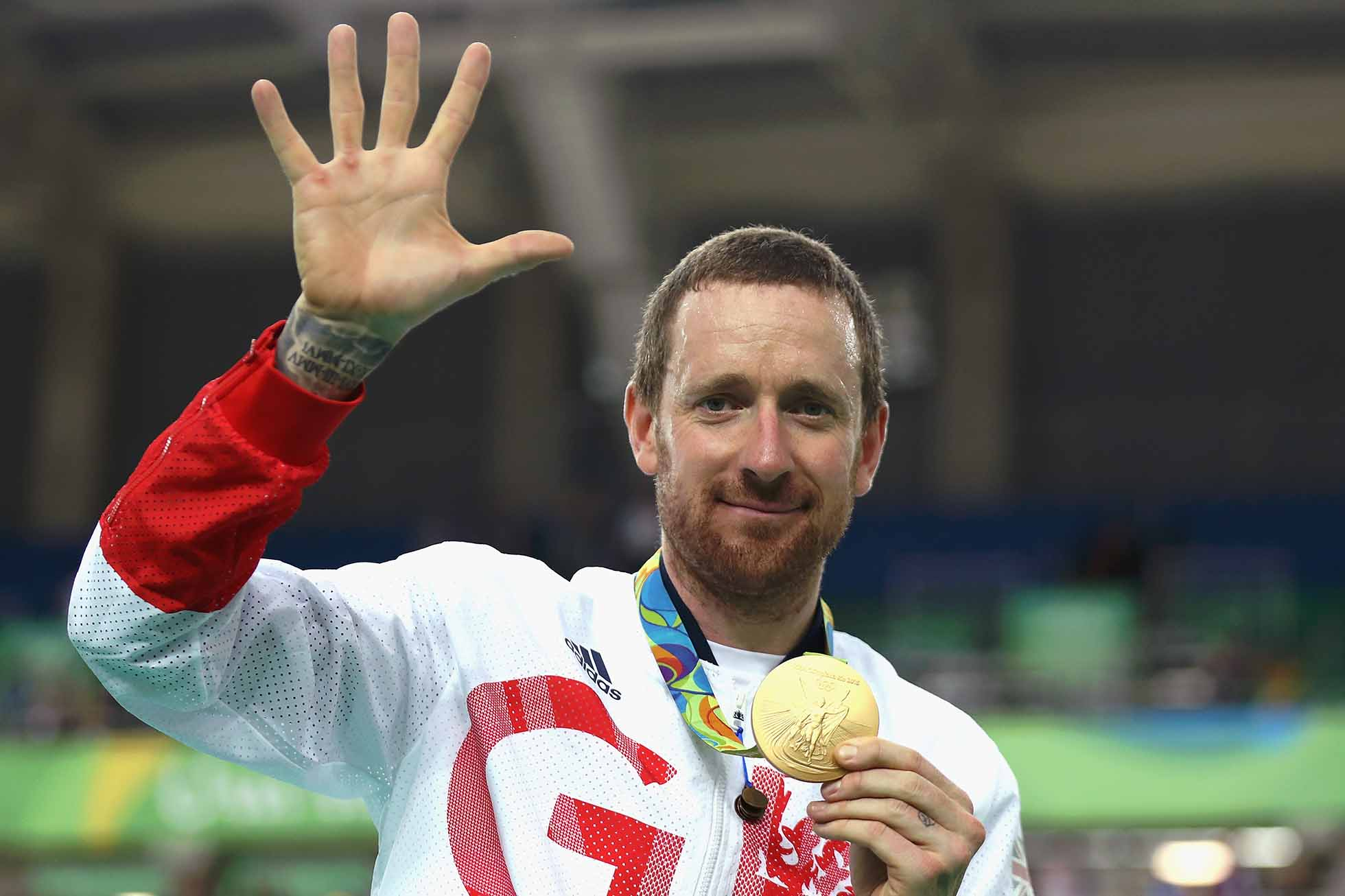 RIO DE JANEIRO, BRAZIL - AUGUST 12: Gold medalist Bradley Wiggins of Team Great Britain poses for photographs with his fifth gold medal in his career after at the medal ceremony for the Men's Team Pursuit on Day 7 of the Rio 2016 Olympic Games at the Rio Olympic Velodrome on August 12, 2016 in Rio de Janeiro, Brazil. (Photo by Bryn Lennon/Getty Images)
