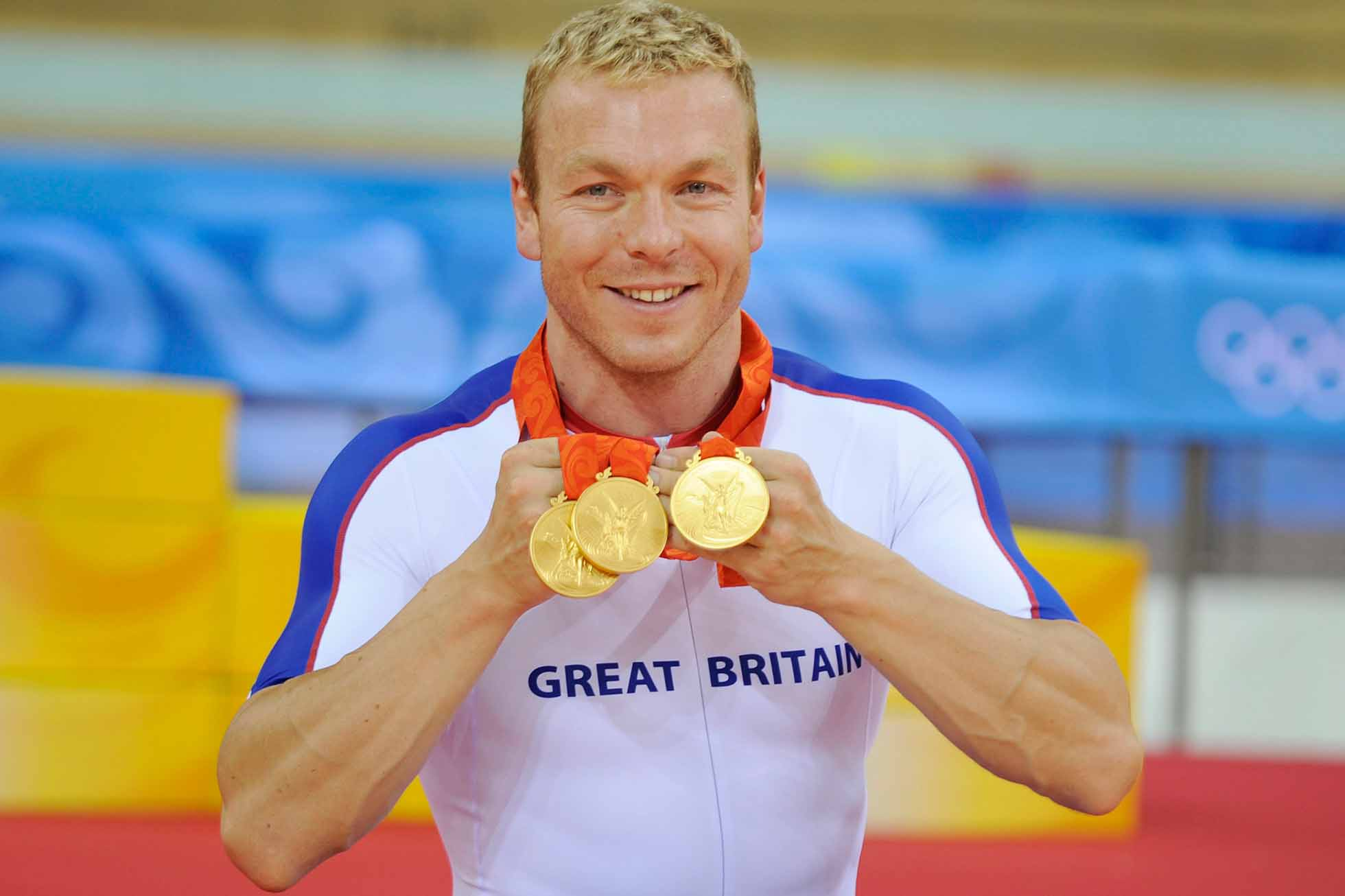 Chris Hoy (GBR) with the three gold medals he won in cycling at the games at the Summer Olympic Games in Beijing China 19th August 2008. (Photo by David Ashdown/Getty Images)