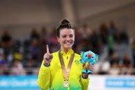 BRISBANE, AUSTRALIA - APRIL 08: Amy Cure of Australia celebrates with her gold medal on the podium after winning the Women's 10km Scratch Race Final track cycling on day four of the Gold Coast 2018 Commonwealth Games at Anna Meares Velodrome on April 8, 2018 in Brisbane, Australia. (Photo by Dean Mouhtaropoulos/Getty Images)