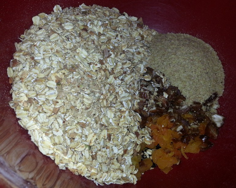 Add the binding mixture to the toasted oats and nuts, wheat germ, and dried fruit.
