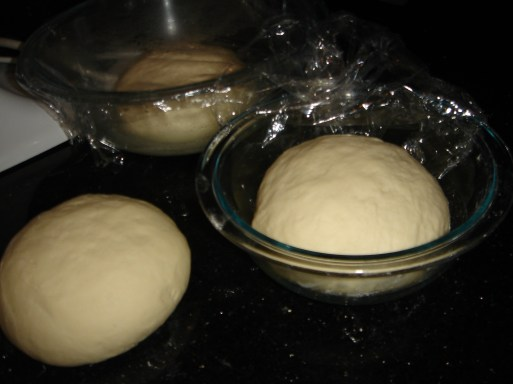 Divide the pizza dough into 3 equal balls; leave to rest for at least 10 minutes.