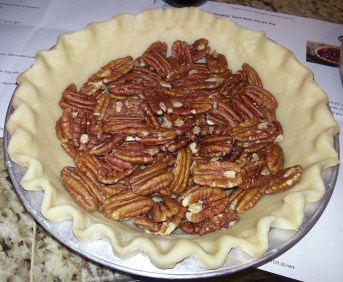 Spread the pecans along the bottom of the pie crust.