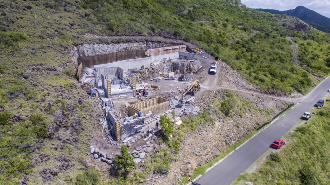 The Cardinal Point house—shown at the top of our post is currently under construction. Upon its completion in November of 2018, the island home will sit nestled in its mountainside location overlooking a protected reef and cove.