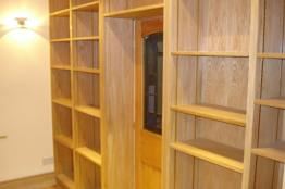 wooden shelves in garage conversion