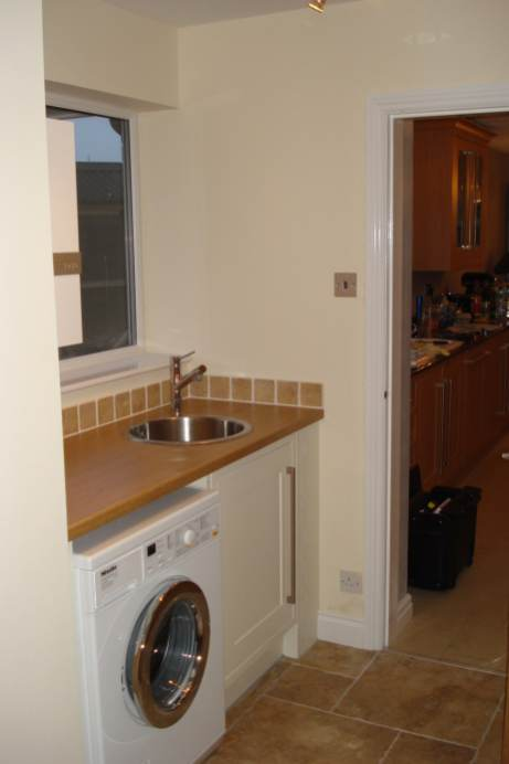 kitchen with sink and washing machine