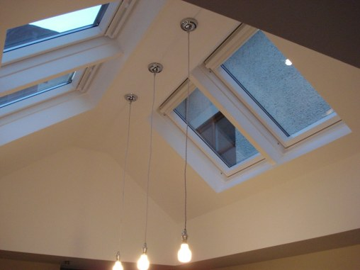 velux windows with three lights hanging from ceiling