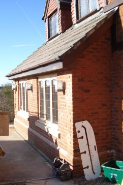 completed external view showing new bricks, windows and lighting