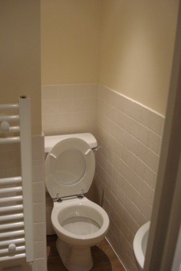 En-suite Shower room with white toilet