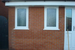 completed garage conversion with frosted glass windows