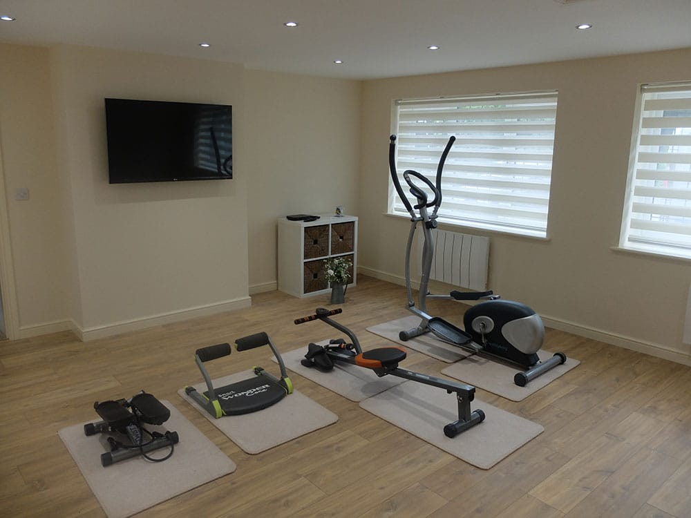 Double garage conversion into gym and games room in culcheth