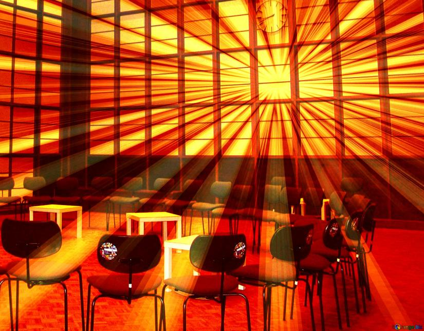 Light streaming in on chairs arranged in circle.